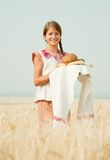 Girl  with bread at field Royalty Free Stock Images