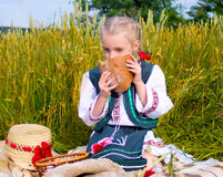 Girl with bread at field Royalty Free Stock Photography