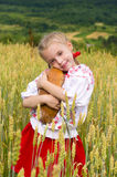 Girl with bread Royalty Free Stock Photography