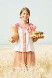 Girl with bread and jug Royalty Free Stock Photo