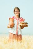 Girl with bread at rye field Stock Images