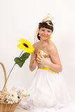 Girl with bread, sunflower and ears of wheat Stock Photo