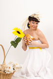 Girl with bread, sunflower and ears of wheat Stock Photography