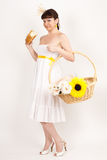 Girl with bread, sunflower and ears of wheat Royalty Free Stock Photos
