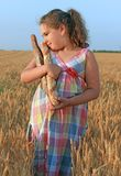 Girl with bread in the wheat field Royalty Free Stock Photography