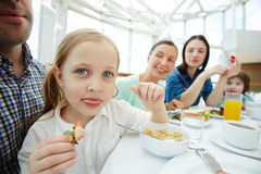 Girl by breakfast Stock Photography