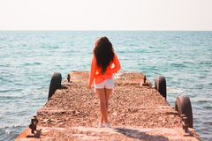 Girl on breakwater Royalty Free Stock Photos