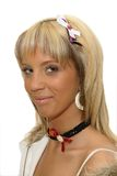 Girl with breast cancer ribbon on the hair royalty free stock image
