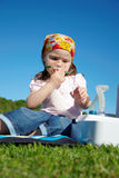 Girl breathe through nebulizer Stock Images