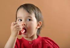 Girl breathing asthmatic medicine. Little girl breathing asthmatic inhaler royalty free stock photo