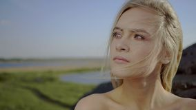 Girl is breathing fresh air. Sensual catching blond girl is breathing fresh air with closed eyes outdoors stock video