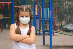 The girl in a breathing mask royalty free stock photos