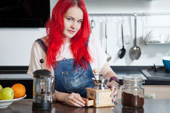 Girl brews coffee in a kitchen room, friends Stock Photo