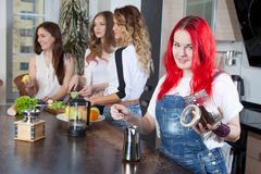 Girl brews coffee in a kitchen room, friends Stock Image