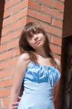The girl at a brick wall Royalty Free Stock Image