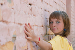 The girl at a brick wall Royalty Free Stock Photo