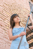The girl at a brick wall Royalty Free Stock Images
