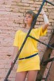 The girl at a brick wall Royalty Free Stock Photos