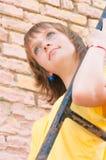 The girl at a brick wall Stock Photos