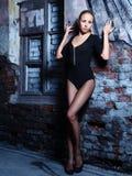 Girl and brick wall Stock Photography