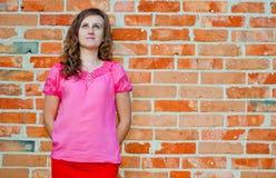 Girl and brick wall royalty free stock image