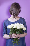 The Girl with bridal bouquet in her hands Stock Photography