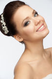 Girl with bridal hairstyle and makeup. Portrait of happy young woman with beautiful bridal hairstyle and makeup royalty free stock photos