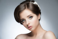 Girl with bridal hairstyle and makeup. Portrait of a young beautiful woman with bridal hairstyle and makeup royalty free stock photos