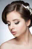 Girl with bridal hairstyle and makeup Stock Images