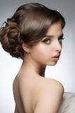 Girl with bridal hairstyle and makeup. Portrait of a young beautiful woman with bridal hairstyle and makeup stock image