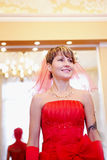The girl bride in a red dress Stock Photo