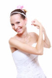 Girl bride shows her muscles strength and power. Woman bride in wedding dress shows her muscles flexing biceps clenching fist isolated on white background Royalty Free Stock Images