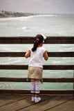 Girl on bridge stock photo