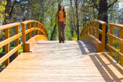 Girl on the bridge. Girl staying in the middle of the bridge royalty free stock photos
