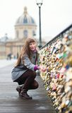 Girl on a bridge looking at lockets Stock Photos