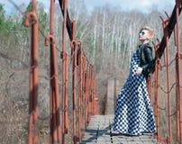 Girl on the bridge over the river Stock Photos