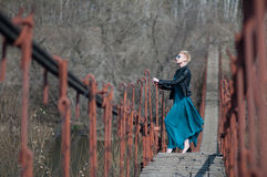 Girl on the bridge over the river Stock Photo