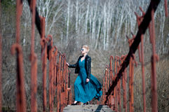 Girl on the bridge over the river Stock Photography