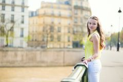 Girl on a bridge in Paris Stock Image