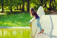 Girl on bridge in park Royalty Free Stock Photos