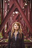 The girl at the bridge piles. Asian girl standing in a leather jacket of bridge piles Stock Image