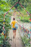 Girl on the bridge. Rope suspension bridge. Colored rope.  Stock Photography