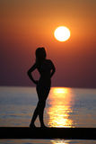 Girl on a bridge at sun set. Royalty Free Stock Photo