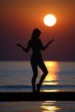 Girl on a bridge at sun set. Royalty Free Stock Photography