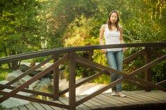 Girl on a bridge Stock Photos