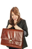 Girl with briefcase. Young woman excitedly holds up her leather briefcase stock photography