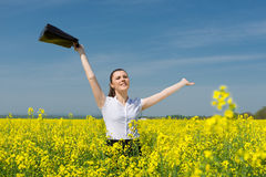 Girl with  briefcase on yellow flower field Stock Image