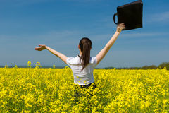 Girl with briefcase on yellow flower field Stock Images