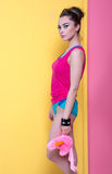 Girl in bright clothes on a colored background, retro style. Royalty Free Stock Images