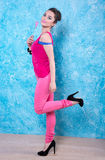 Girl in bright clothes on a contrasting background, retro style. Royalty Free Stock Image